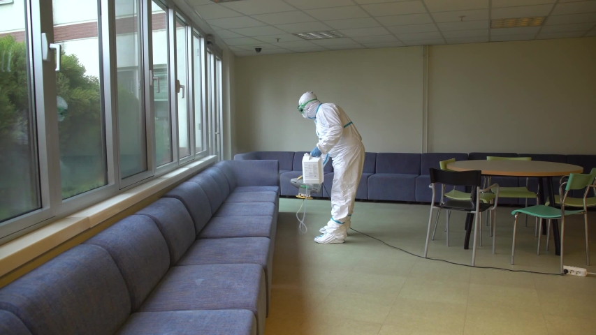 Masked Disinfectant Workers Spraying Sanitizer to Library and Class and Living Areas in Schools for Coronavirus Disease Covid-19 4K High Quality Video Men Working Against Corona Cleaning Public Spaces Royalty-Free Stock Footage #1049776129