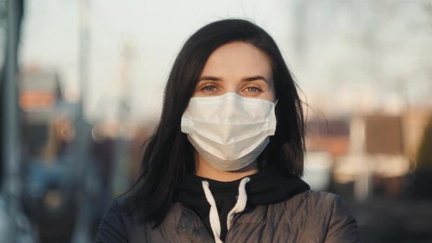 Virus mask spanish woman on street wearing face protection take off mask end finish coronavirus covid 19 quarantine. End pandemic epidemic | Shutterstock HD Video #1049817298