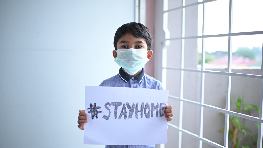 Stay at home .Coronavirus covid-19 infected.Asian Boy Wearing Masks to Prevent Disease and Dust, pm.5,Stay at home quarantine coronavirus pandemic prevention. Royalty-Free Stock Footage #1049818096