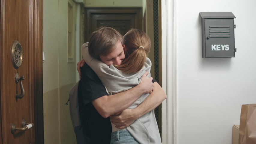 Man come back home after coronavirus quarantine is over, happy couple hugs, boyfriend went home first days, home isolation, open boarders, end, back and return to family, happy girlfriend met hugs | Shutterstock HD Video #1049836228