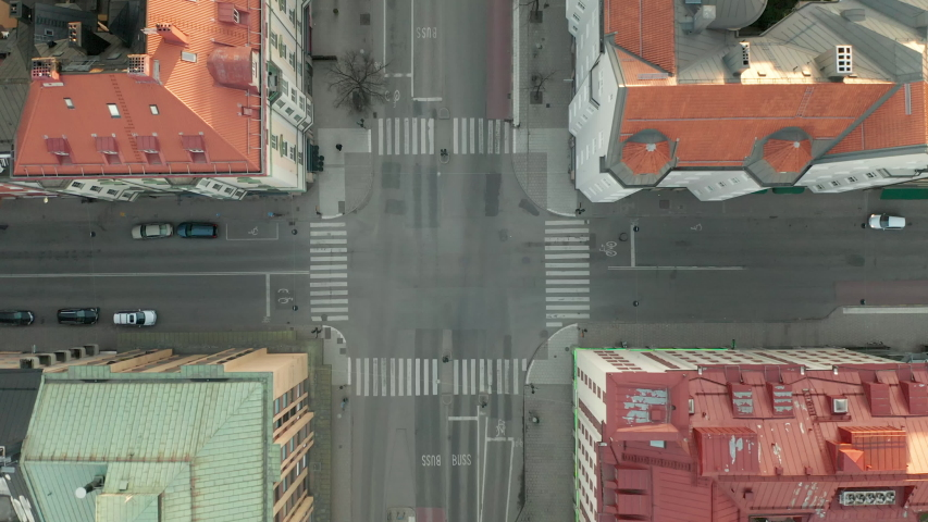 Rising aerial shot of empty intersection during Coronavirus Covid-19 outbreak | Shutterstock HD Video #1049836624