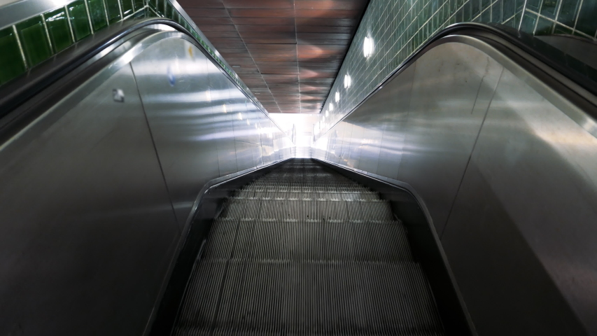 EUROPE IN LOCKDOWN - An escalator of a metro station lies empty after a spike in the number of cases of CORONAVIRUS / COVID-19 infections, with a dramatic impact on social life | Shutterstock HD Video #1049845069