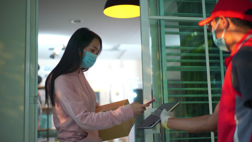 The courier delivers food home. Delivery of food in quarantine | Shutterstock HD Video #1049849299