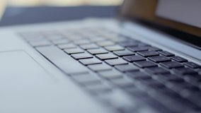 Closeup of laptop keyboard with a woman typing slowly. Footage shot with RED, available in 4K and HD. Download the preview for free.