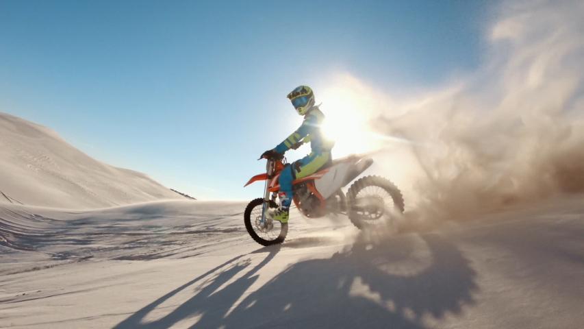 Skilled motocross rider drives on the sand dune. Dirt biker off roading on sand dunes in desert.  | Shutterstock HD Video #1049895538