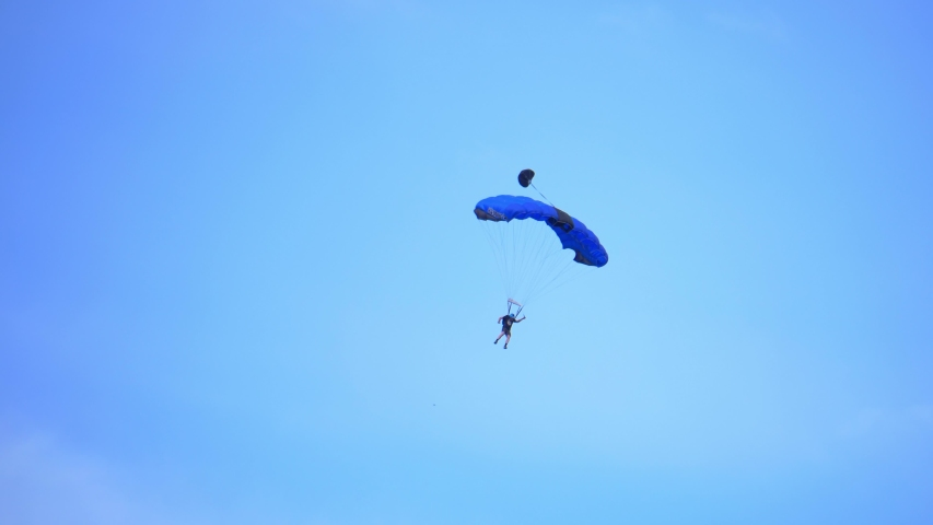 Fayetteville, Tennessee / USA - November 14 2019: Parachuting Through Beautiful Blue Sky, Sky Diving, Base Jumping