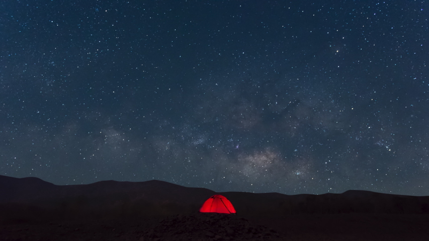Red tent under Milky Way Galaxy Time Lapse Lampang Thailand, Universe galaxy milky way time lapse, dark milky way, galaxy view, star lines, timelapse night sky stars on sky background. 4K Resolution. Royalty-Free Stock Footage #1049926549