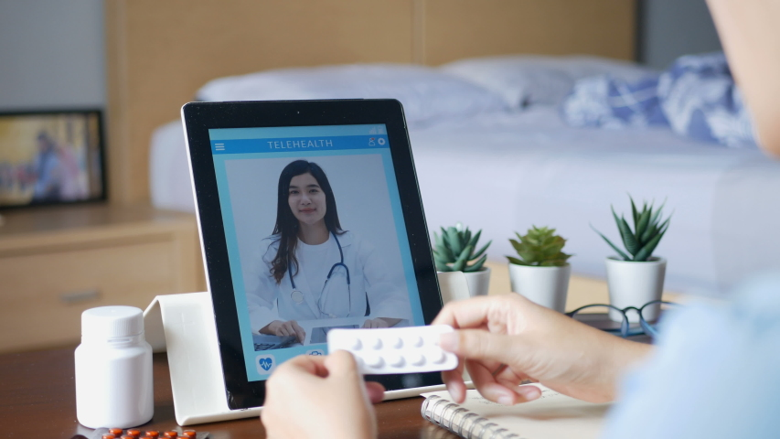 4K. sick woman use video conference, make online consultation with doctor via tablet, patient ask doctor about illness and medication via video call. Telehealth, Telemedicine and online hospital Royalty-Free Stock Footage #1049933536