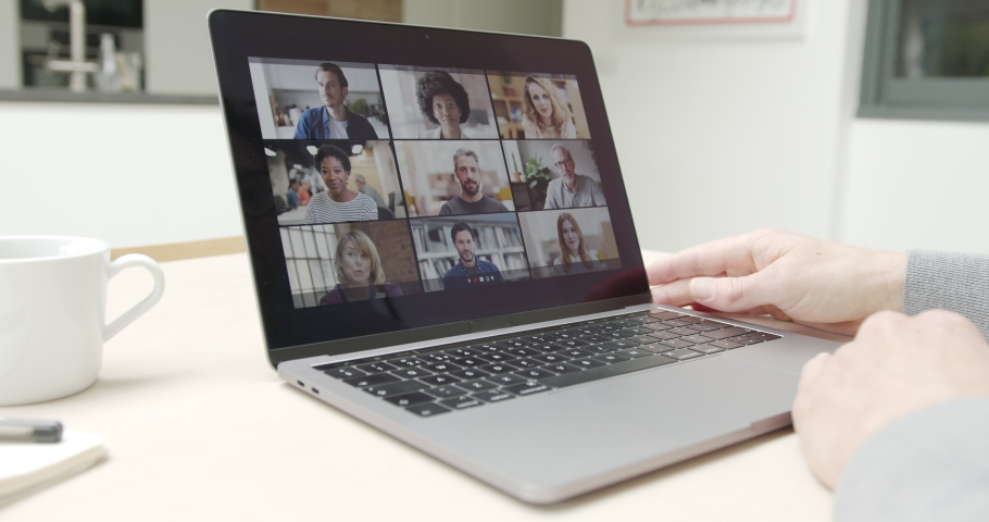 Person Using Video Conferencing technology in kitchen for video call with colleagues at home and in offices | Shutterstock HD Video #1049941168