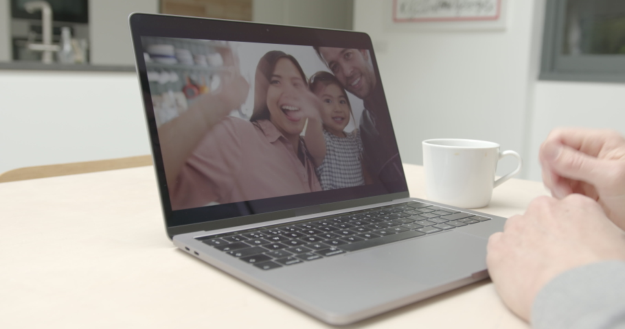 Family Using video call at home to connect with family at home in kitchen | Shutterstock HD Video #1049941528