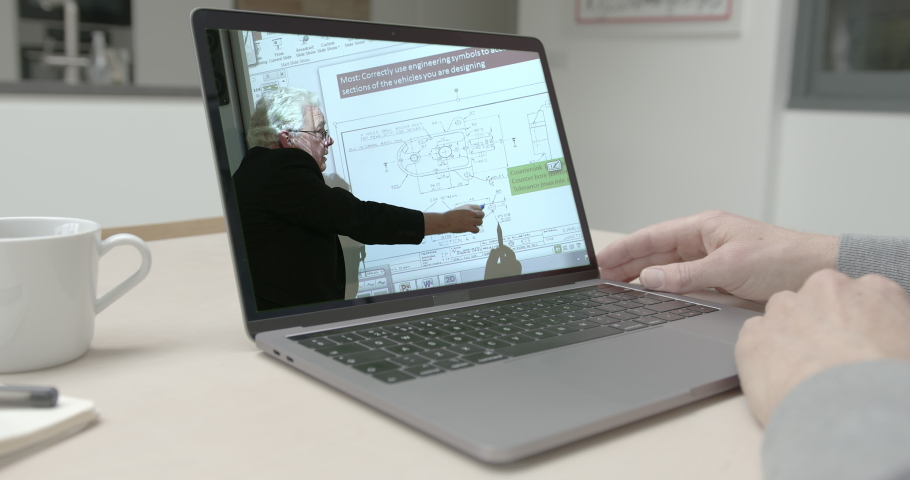 Online education, man at kitchen table video call with tutor in class room teaching and explaining engineering on interactive white board  | Shutterstock HD Video #1049943046