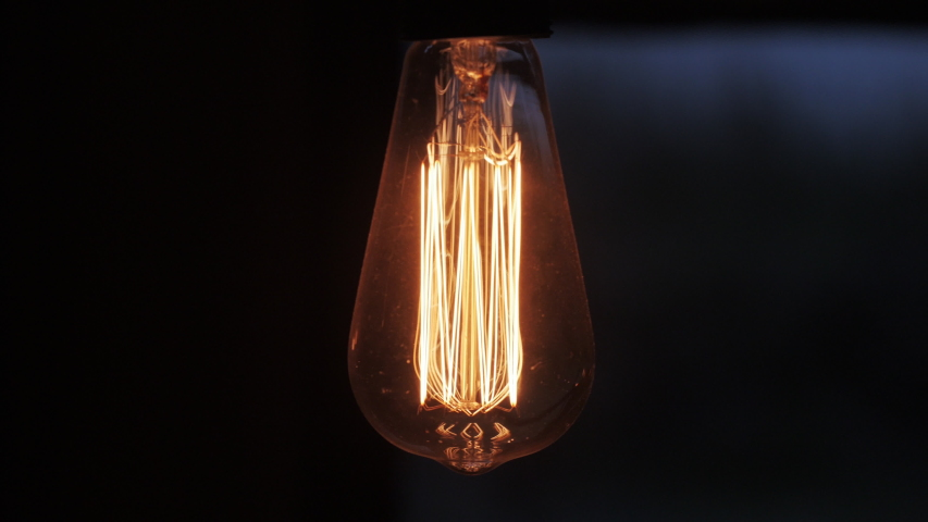 4k Close-up Of A Tungsten Light Bulb Switching On. Energy, Electricity, Innovation Concept.  | Shutterstock HD Video #1049965795