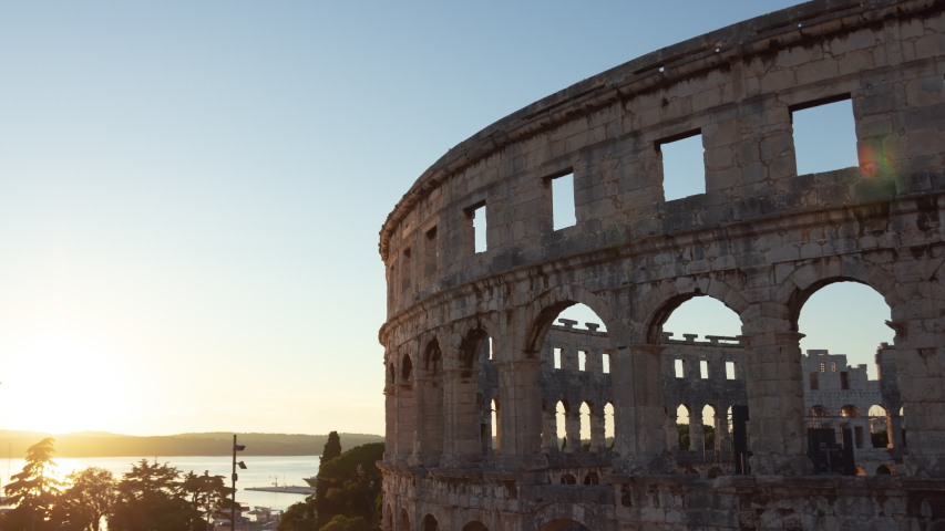 Sunset / Day-to-night Time Lapse Of Pula Arena. Landmarks, Ancient Architecture, Travel Concept. Location: Pula, Croatia, Europe. June Of 2019. Royalty-Free Stock Footage #1049966509