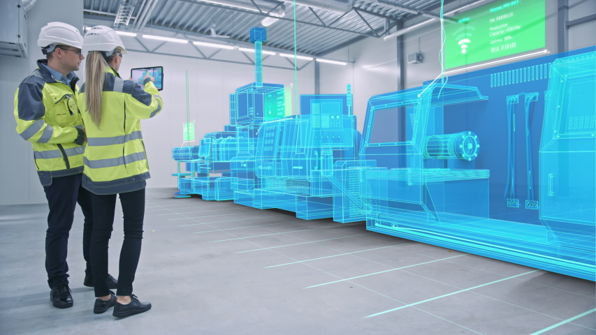 Two Engineers Use Digital Tablet Computer with Augmented Reality Software to Create 3D CNC Machinery, Equipment Visualization in Factory. Industry 4.0 Facility. VFX Special Visual Effect Graphics