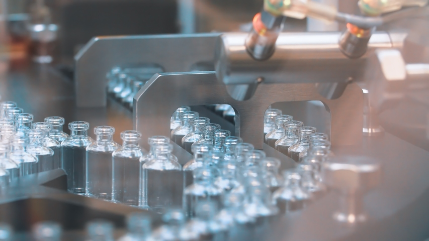 Medical vials on the automatic production line of vaccines and injections. coronavirus. Royalty-Free Stock Footage #1049969101
