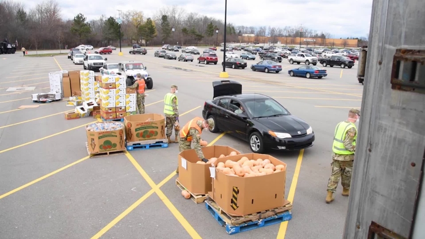 CIRCA 2020 - U.S. army soldiers distribute food at a West Michigan food bank during the Covid-19 outbreak food shortage.