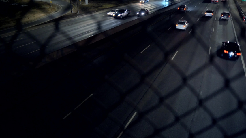 View of night time traffic on interstate highway in Denver, Colorado