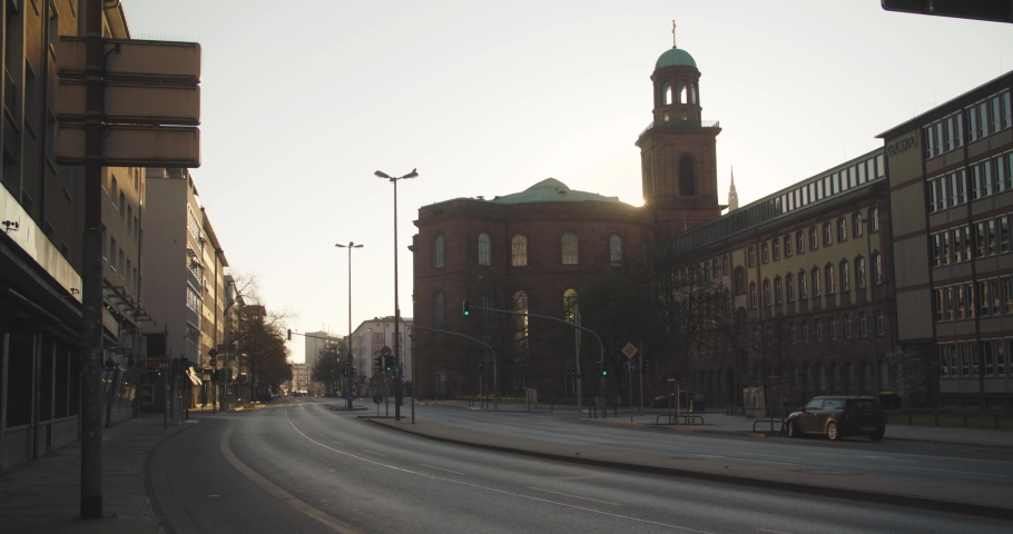 Covid-19 pandemic lockdown. Frankfurt, Germany. April 5, 2020. Empty Berliner Street and sun rising behind St. Paul's church.