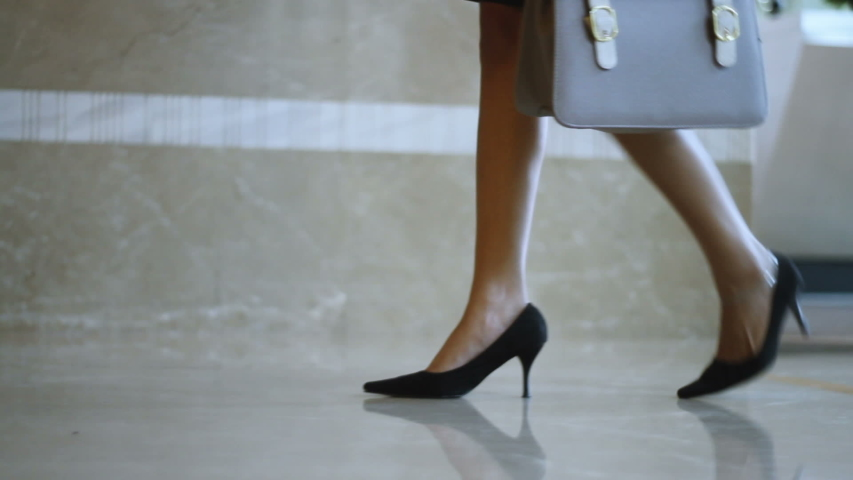 Elegant business woman legs entering and passing security gate office building or hotel lobby | Shutterstock HD Video #1049986699