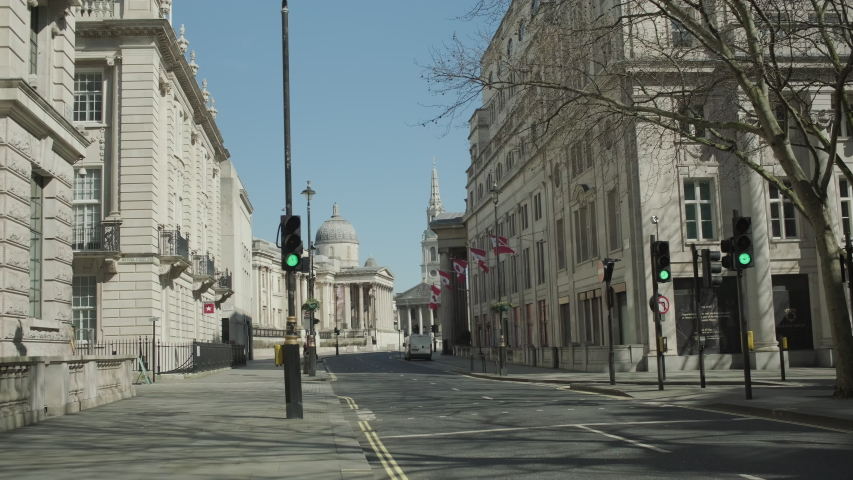 LONDON, ENGLAND, UK –  April 6 2020: Lockdown London, Empty road towards Trafalgar Square during coronavirus pandemic, no people