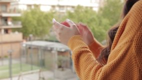Stock video of the hands of a girl clapping on the balcony to support those who fight coronavirus