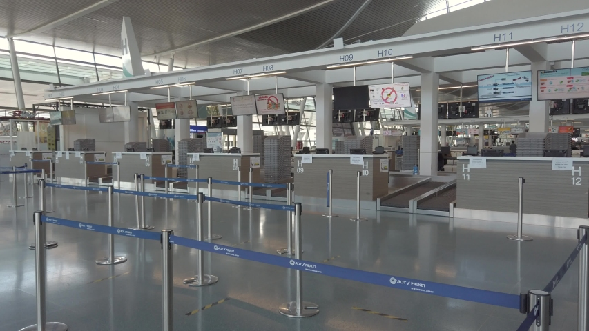 April 3,2020: Phuket International Airport,Phuket,Thailand : Interior view inside international terminal in daytime without people due to coronavirus outbreak cove-19 crisis.Phuket airport closed