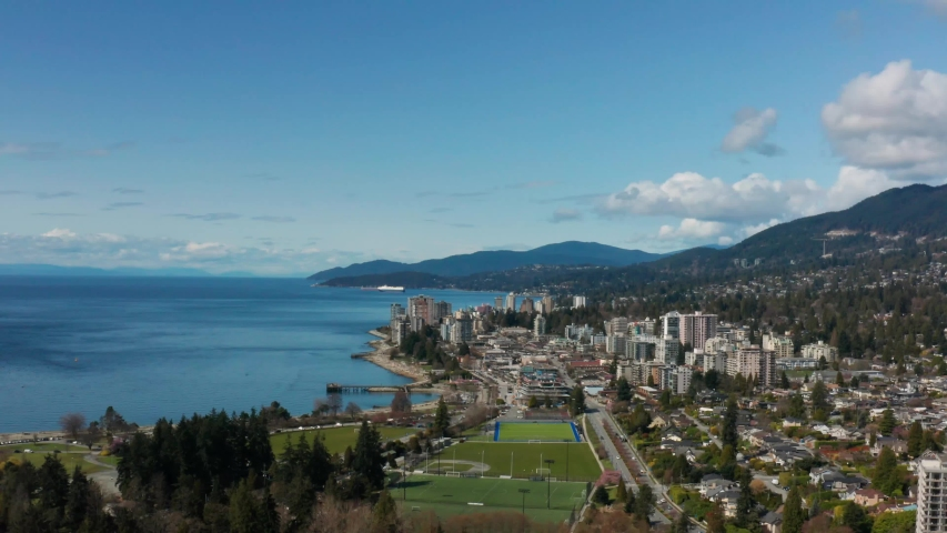 Beautiful aerial view over the Marine Drive and Ambleside West Vancouver to the Pacific Ocean