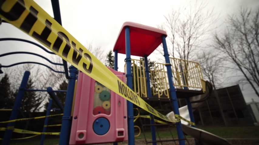 Children's playground is closed. Focus on yellow caution tape due coronavirus COVID-19 pandemic. No children on the Playground is allowed. Ban on children 's playgrounds. The fight with virus.