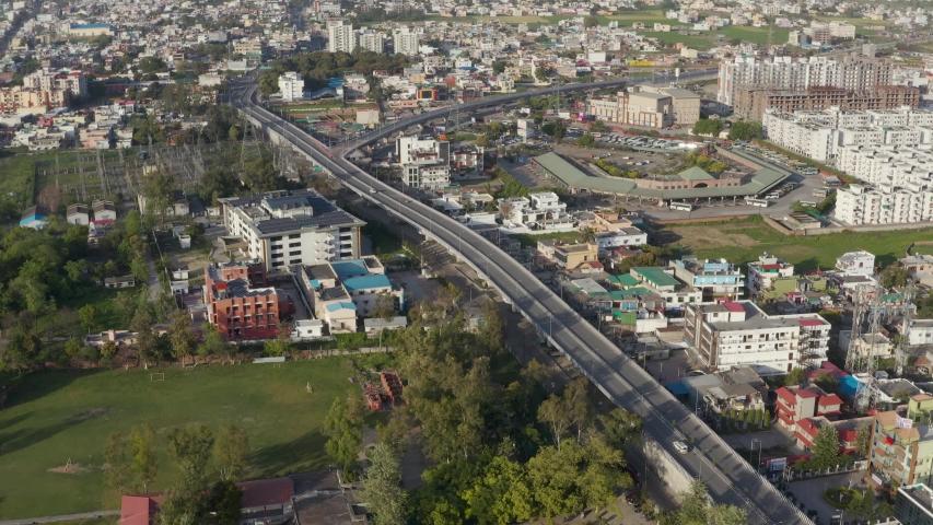 India Lock down-Coronavirus- Aerial view of Dehradun city of India during lockdown because of Coronavirus pandemic. Empty roads, no traffic. 4k.  Royalty-Free Stock Footage #1050088201