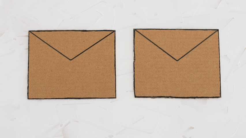 online scams concept, email envelop icons with hand placing real vs fake labels on them Royalty-Free Stock Footage #1050088795