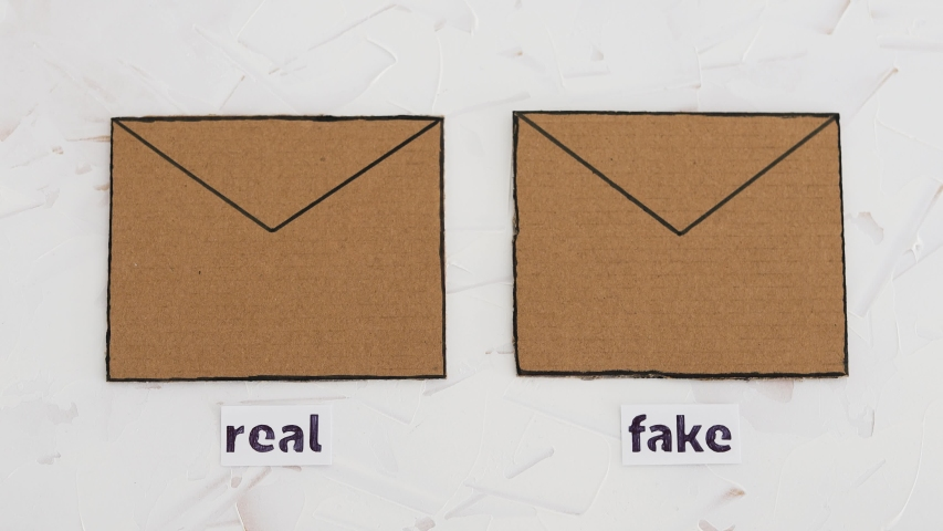 online scams concept, email envelop icons with real vs fake labels on them and camera defocusing Royalty-Free Stock Footage #1050088801