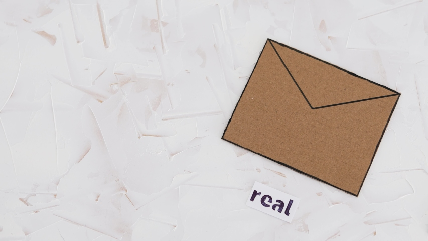 online scams concept, email envelop icons with real vs fake labels on them and camera panning around the scene Royalty-Free Stock Footage #1050088807