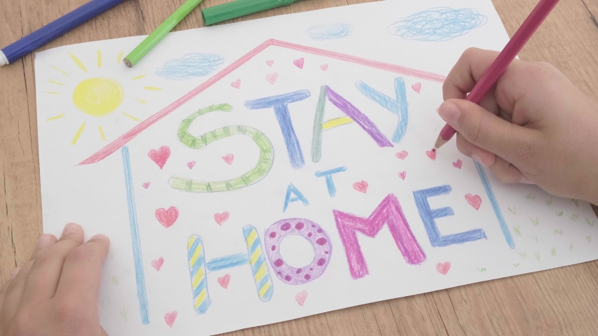 Social media campaign for pandemic coronavirus covid-19 prevention. Kid drawing with colored pencils during quarantine at home. Drawing with Inscription message Stay at home | Shutterstock HD Video #1050092287