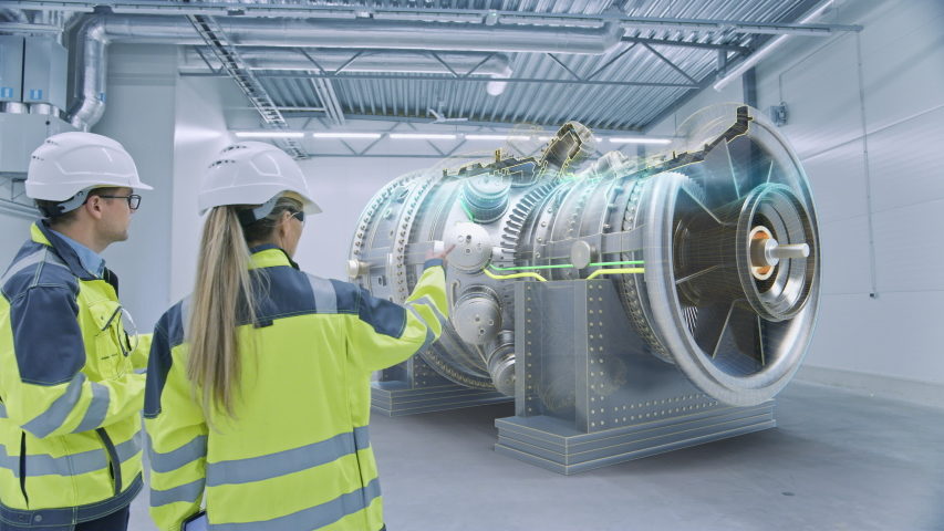 Industry 4.0: Two Engineers Standing, Talking in Factory Workshop with Augmented Reality 3D Model Engine, Analysing Components, Fuel Use Efficiency. VFX Special Visual Effects, Graphics Visualization