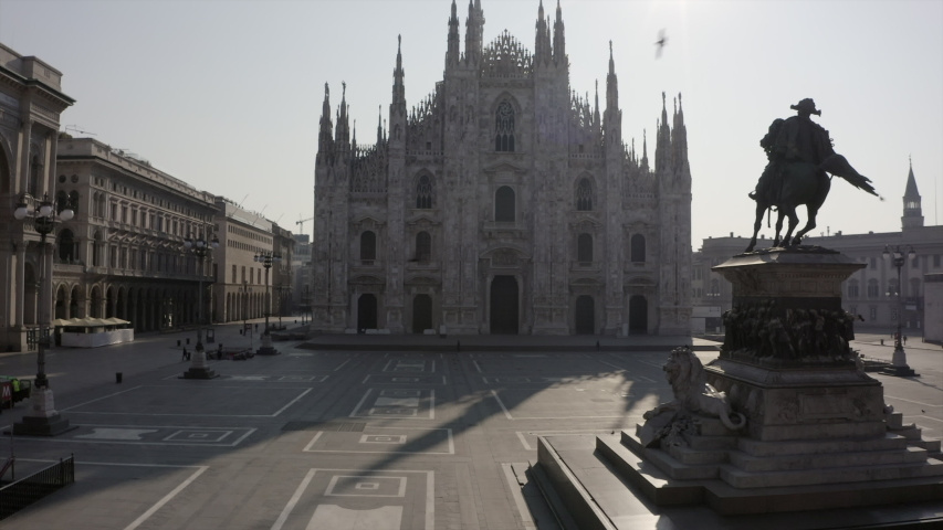 Everyday life in Milan, Italy during COVID-19 epidemic. Milano, Italian city and coronavirus lockdown. Aerial view of Piazza Duomo with cathedral seen from drone flying in sky
