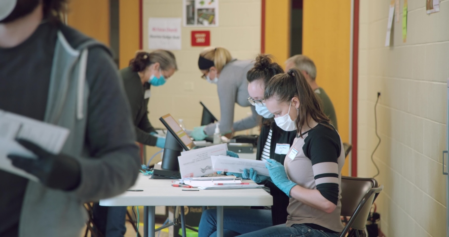Election during the Coronavirus or Covid-19 pandemic, voters participating in a election in Madison, Wisconsin/USA April 7, 2020