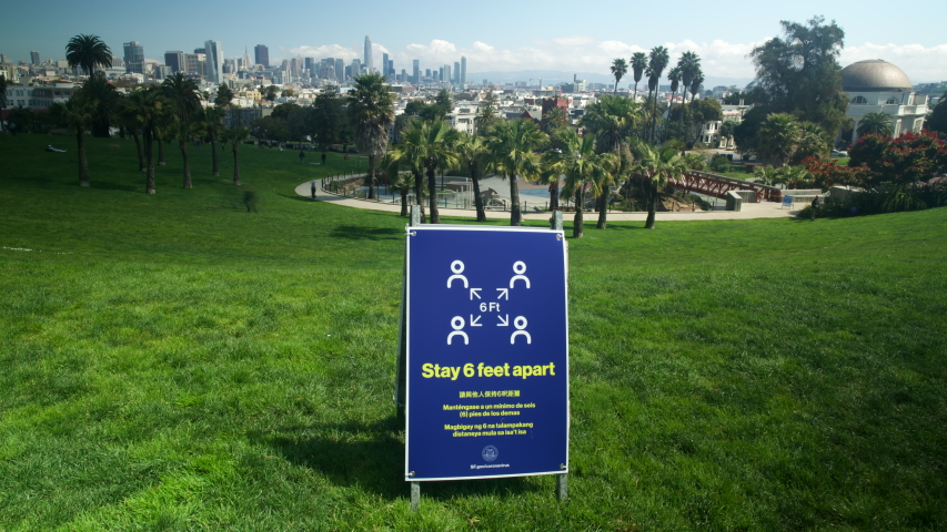 San Francisco, California / U.S.A. - April 3rd, 2020 Time lapse of Dolores Park with shelter in place keep 6 foot distance sign in San Francisco during Covid-19 pandemic.
