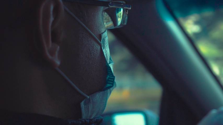 Cinematic inspirational video of adult man driving car and other transport passes him. Male in vehicle on town | Shutterstock HD Video #1050251494