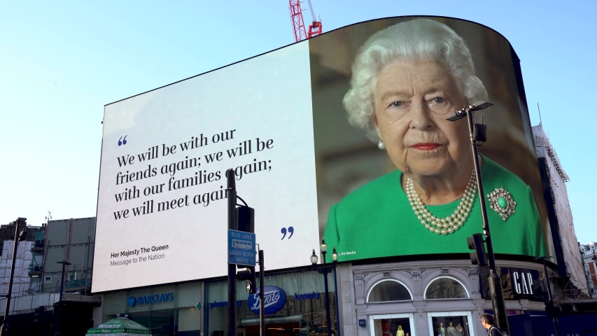LONDON, UK - April 11th 2020: Queen Elizabeth II of England, Thank you NHS, COVID-19 corona virus pandemic, Stay Home, Save Lives, screen sign information panel message, Piccadilly circus, London