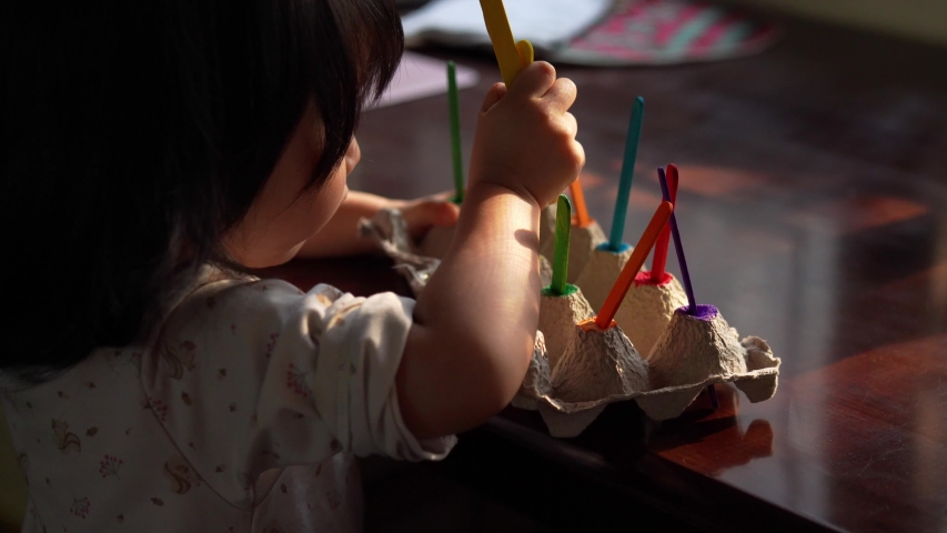 Homeschooling sensory activities for toddler made by mother during the Covid-19 coronavirus pandemic, self-quarantine, social distancing, lockdown, concentration, Creative skills, Montessori education | Shutterstock HD Video #1050276985