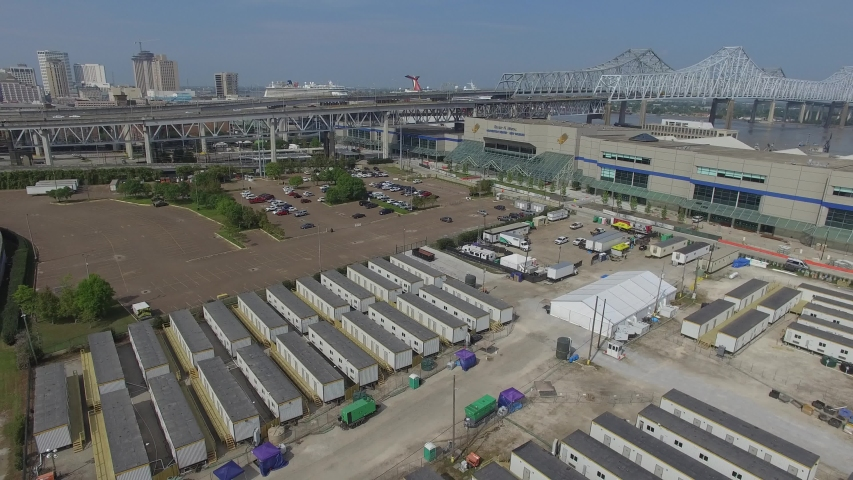 New Orleans, Louisiana - 4/9/2020: Aerial footage of COVID-19 Coronavirus operations outside of the Morial Convention Center in New Orleans, Louisiana. Trailers, tents and ambulances visible.