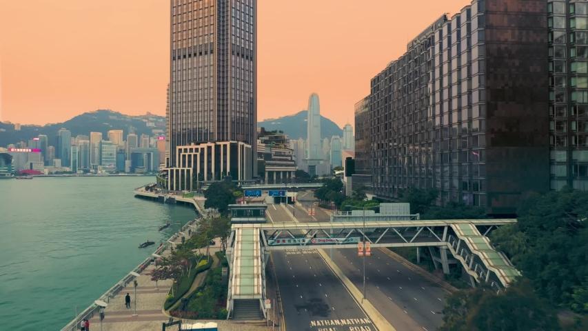 Hong Kong, China - 2020: hotel Rosewood Hong Kong and Salisbury Road from above. Wing On Plaza, Kowloon Shangri-La, Crossing Bridge, Avenue of Stars. Buildings and streets at sunset.