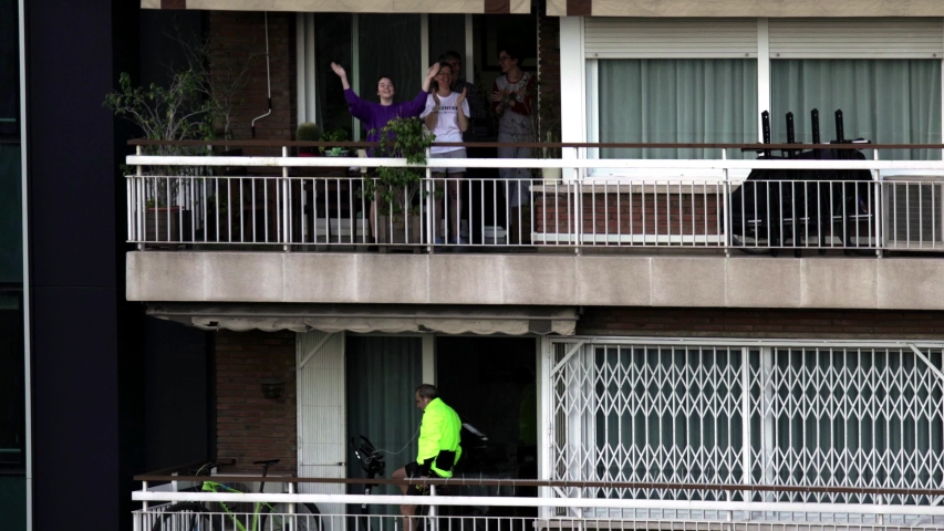 Neighbors in Balconies during Coronavirus Lockdown to Boost Morale. March, 2020. Barcelona,Spain. Quedate en casa hashtag