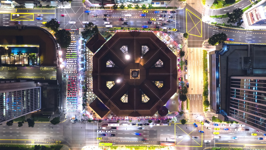4K time-lapse of car traffic transport at square junction road intersection in Singapore city downtown district, drone aerial top view zoom out. Transportation technology, Asian city life, Asia travel Royalty-Free Stock Footage #1050311956
