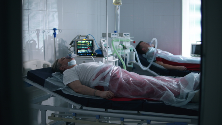 Coronavirus, covid-19 infected patients in a clinic. Hospital ward with two patients connected to medical ventilators | Shutterstock HD Video #1050320290