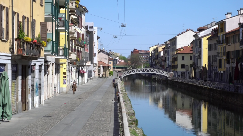 Italy , Milan - Vicolo dei Lavandai ( ancient public washrooms ) Navigli Canals  Downtown of the city empty of people during n-cov19 Coronavirus outbreak epidemic quarantine home - lockdown Royalty-Free Stock Footage #1050336331