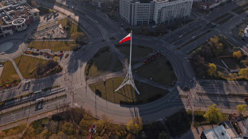 Aerial View of Warsaw, empty Rondo Radosława roundabout with the Polish flag. Beautiful sunny day, shot in 5.2K CDNG, Warszawa, Poland, Polska | Shutterstock HD Video #1050340207