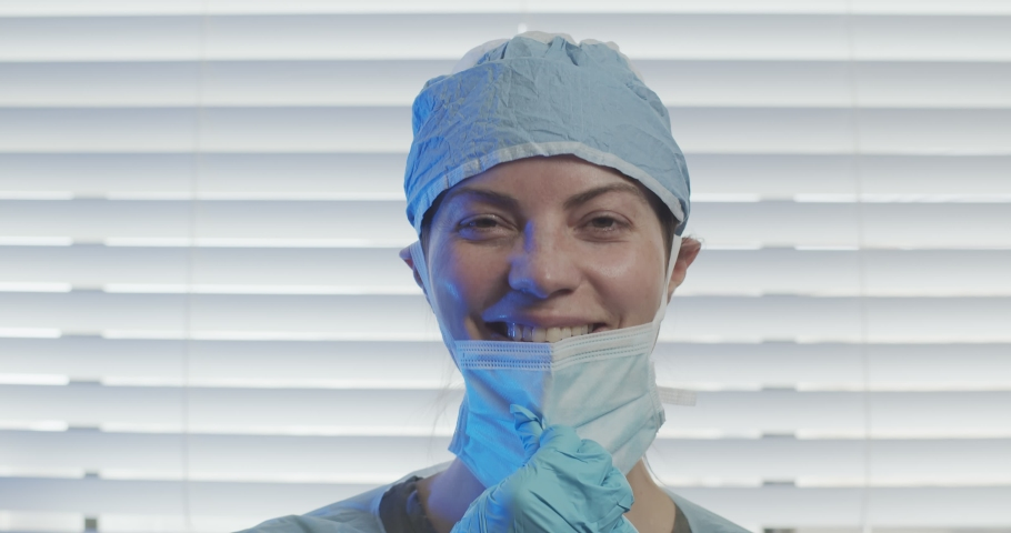 Portrait of a front line health working during the COVID-19 pandemic. Remove mask. Shot in 4K on a cinema camera. | Shutterstock HD Video #1050349207