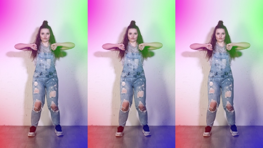 Funny girl dancing. Funny pose. The party is in full swing. Happy carnival. The teenager moves funny. Vertical video for smartphone and phone. Infinity animation.