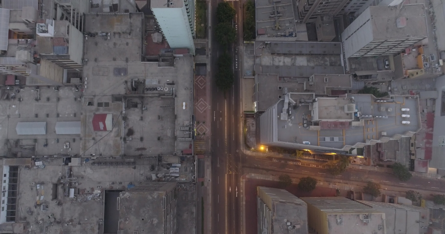 Aerial images in Lima Peru in the afternoon/night during COVID19 quarantine lockdown. Empty streets and avenues, due to pandem. | Shutterstock HD Video #1050399112